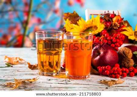 Fresh juice, autumn concept with seasons vegetable on wooden table