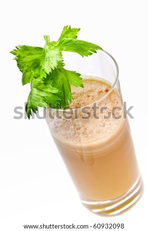 fresh juice from celery in glass isolated on white