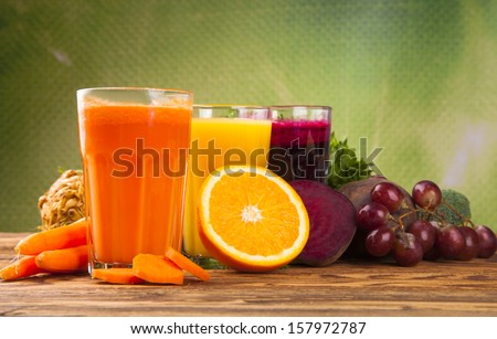 Fresh juice Healthy drink on wood