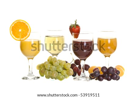 fresh juice in glass surrounded by fresh fruit