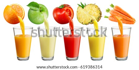 Fresh juice pours from fruit and vegetables into the glass isolated on white background.