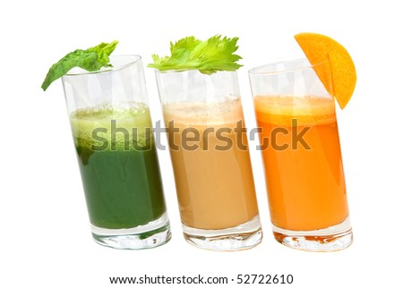 fresh juices from carrot, celery and parsley in glasses isolated on white