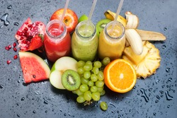 Fresh Juices Smoothie Red Green Yellow Tropical Fruits Water Melon Strawberry Apple Kiwi Orange Mango Banana Pine Apple Pomegranate Grape Selective focus Bottles multi-colour