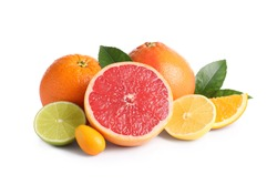 Fresh juicy citrus fruits with green leaves on white background