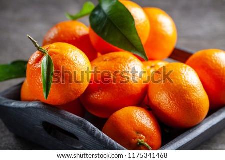 Fresh juicy clementine mandarins, winter time fruits.  #1175341468