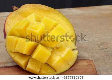 Fresh juicy cutting mango on a wooden table. Shallow depth of field Photo stock ©
