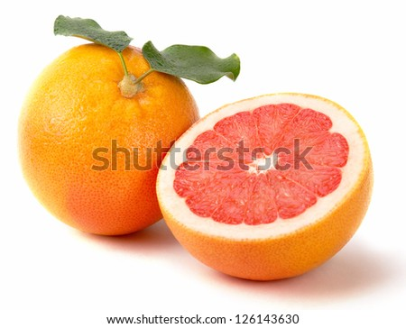 Fresh juicy grapefruits with green leaf