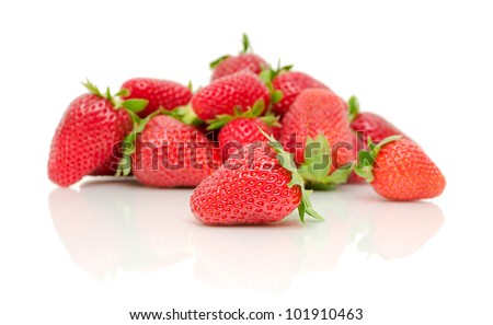 Fresh juicy strawberries on a white background with reflection closeup