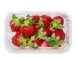 Fresh juicy strawberry in a plastic bag on a white background. Produce product of agriculture industry. Top down view