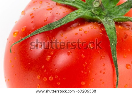 Fresh juicy tomato close up isolated on white