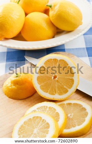 Fresh juicy yellow lemons, sliced for garnishing beverages or fish entrees, perfect for making lemonade