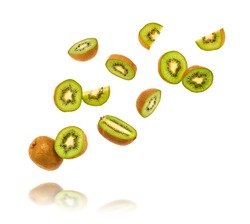 Fresh kiwi fruit flying in air isolated on white. Healthy fruity green color diet food. Sweet summer whole, cut kiwi background. Colorful levitation, falling fly kiwi fruit creative concept