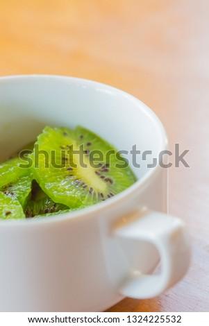 Fresh kiwi fruits on wooden table  #1324225532