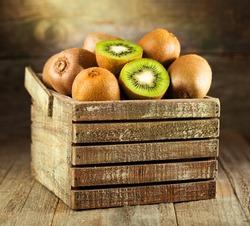 fresh kiwi in a wooden box