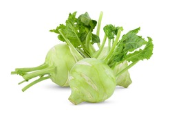 Fresh kohlrabi with green leaves on isolated white backround. full depth of field