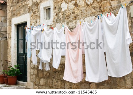 Fresh laundry hanging on a clothesline in downtown (Dubrovnik, Croatia)