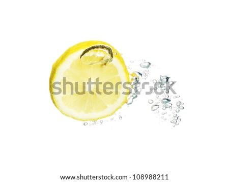 Fresh lemon fruit splashing in the water isolated on white background