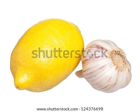 Fresh lemon with raw garlic isolated on white background