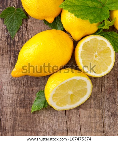 Fresh lemons on wooden table, top view