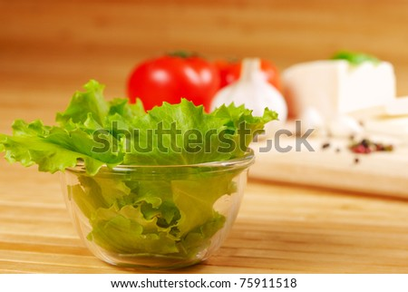 Fresh lettuce with vegetables on the background