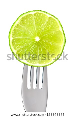 fresh lime fruit slice on a fork isolated against white background
