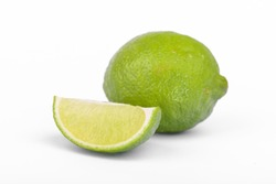 Fresh lime, half and quarter part on white background. Green citrus fruit.