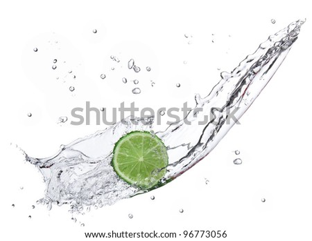 Fresh lime with water splash isolated on white - stock photo