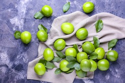Fresh limes on color background