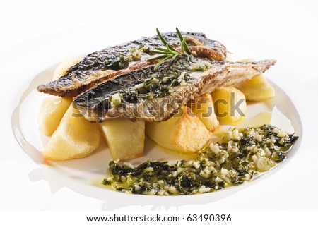 Fresh mackerel fillet with baked potato close up