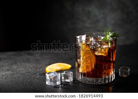 Fresh made Cuba Libre cocktail with brown rum, cola and lemon on wooden background Photo stock ©