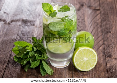 Fresh made Mojito on wooden background