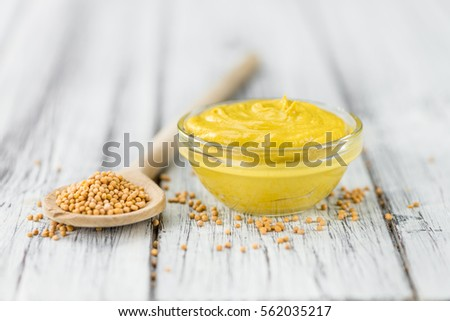 Fresh made Mustard on a vintage background (close-up shot) #562035217