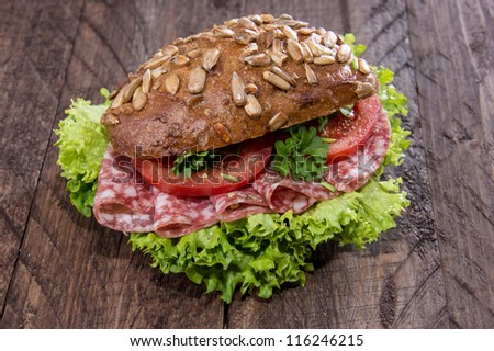 Fresh made Salami Sandwich on wooden background