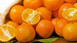 fresh mandarin oranges fruit on wooden table