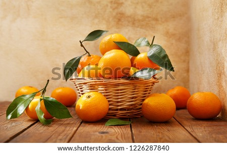 Fresh mandarin oranges fruit or tangerines with leaves on wooden table ストックフォト ©