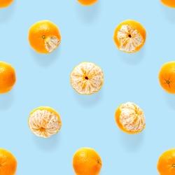 Fresh mandarine Seamles pattern. Ripe fruit tangerines seamless pattern. Fresh citrus isolated on blue background pattern. Flat lay of Clementine.