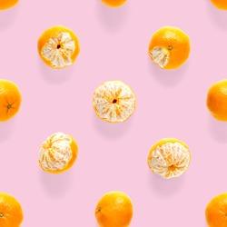 Fresh mandarine Seamles pattern. Ripe fruit tangerines seamless pattern. Fresh citrus isolated on pink background pattern. Flat lay of Clementine.