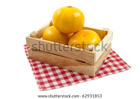 fresh mandarins in a wooden crate isolated over white - stock photo