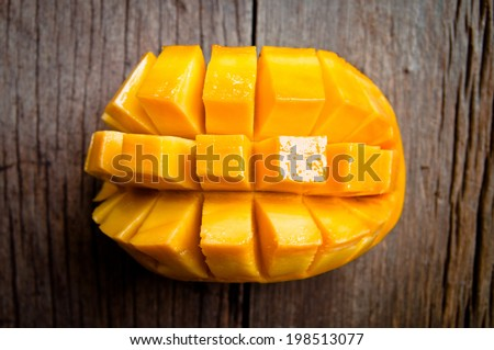 Fresh Mango , Cut in Square Shape Concept of Food Art, Idea of Decorated Food, On Wood Table Background, Rustic Style.