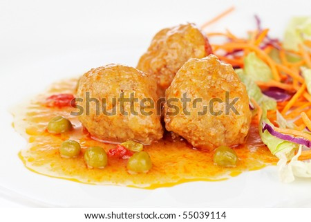Fresh meatballs with salad on white plate. Shallow depth of field