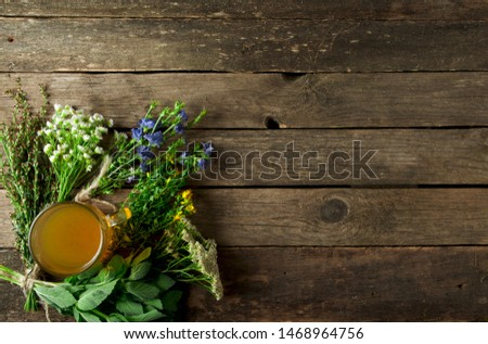 Fresh medicinal herbs. Medicinal herbs (chamomile, wormwood, yarrow, mint, St. John's wort and chicory) on an old wooden board. View from above. Copy space #1468964756