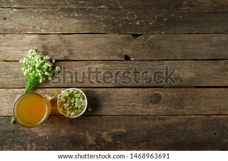 Fresh medicinal herbs. Medicinal herbs on an old wooden board. View from above. Copy space