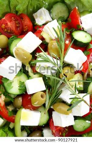 Fresh mediterranean salad with tomatoes, pepper and cheese, closeup