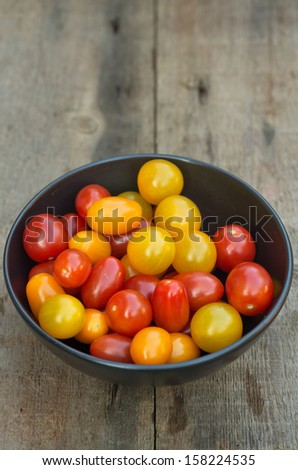Fresh Meli Melo Heirloom tomatoes in rustic setting