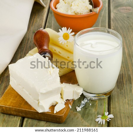 Fresh milk and dairy products on a wooden table. Selective focus