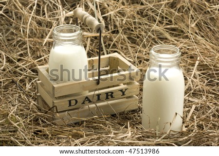 Fresh milk from dairy on haystack