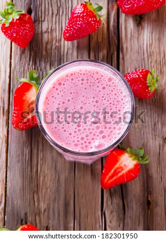 Fresh milk, strawberry drink on wodeen table, assorted protein cocktail with fresh fruits.