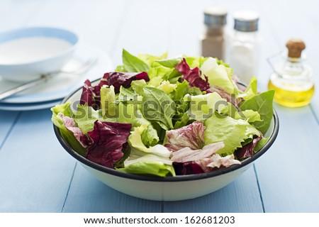 Fresh mixed green salad in a bowl close up Сток-фото ©