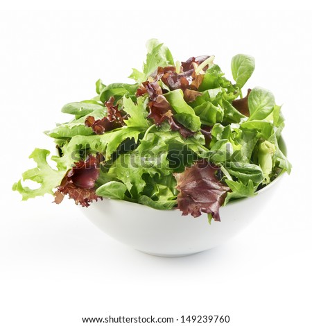 fresh mixed salad in a bowl on a white background
