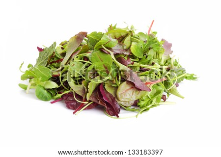 fresh mixed salad leaves over white background